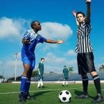 argument_soccer-player-referee_msclipart_450px